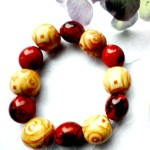 bronze_swirl_yellow_wood_and_orange_marbled_beaded_stretch_bracelet_a_de107dec3.jpj